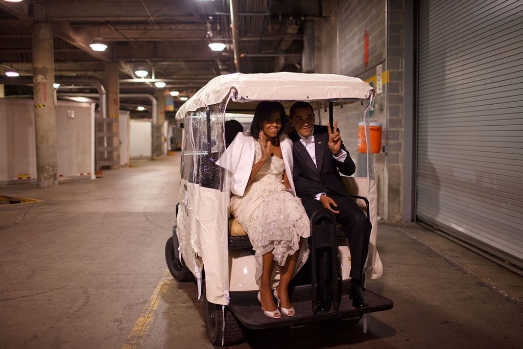 President Barack Obama and First Lady Michelle Obama ride in a golf cart  an Inaugural ball 1/20/09Official White House Photo by Pete Souza