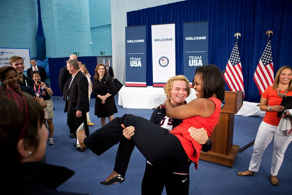 First Lady Michelle Obama is picked up by U.S. Olympic wrestler Elena Pirozhkova during a greet with Team USA Olympic athletes competing in the 2012 Summer Olympic Games, at the U.S. Olympic Training Facility at the University of East London in London, England, July 27, 2012. (Official White House Photo by Sonya N. Hebert)This official White House photograph is being made available only for publication by news organizations and/or for personal use printing by the subject(s) of the photograph. The photograph may not be manipulated in any way and may not be used in commercial or political materials, advertisements, emails, products, promotions that in any way suggests approval or endorsement of the President, the First Family, or the White House.Ę