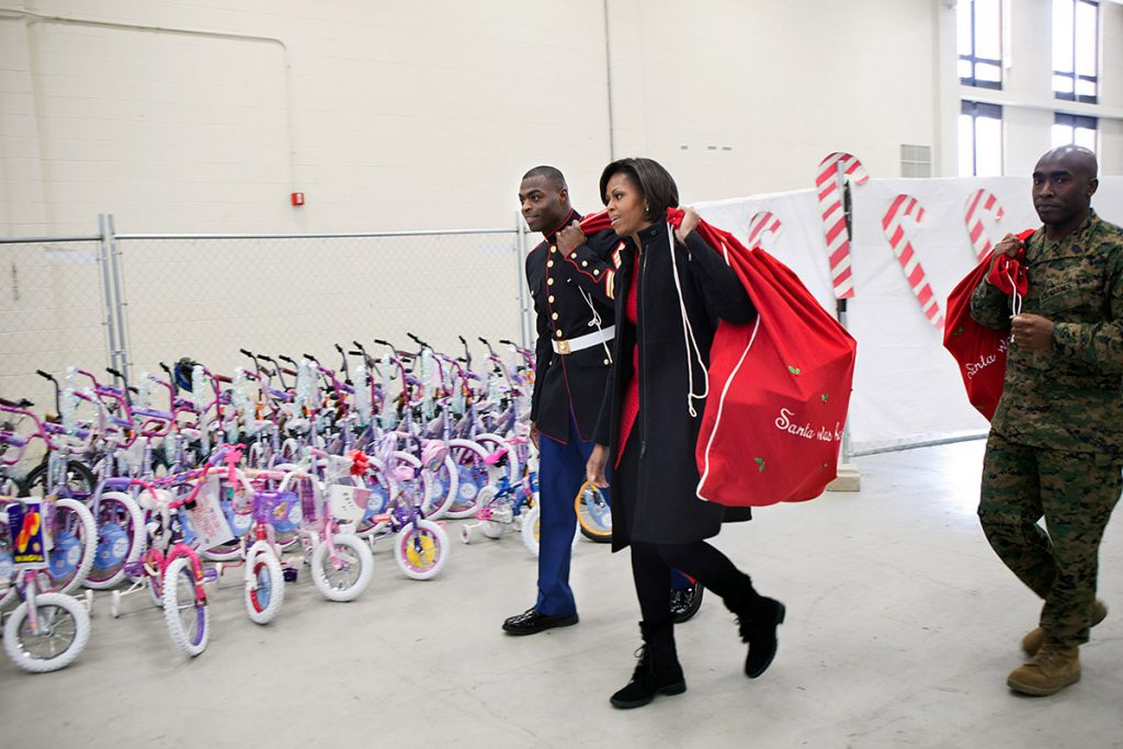 """First Lady Michelle Obama participates in a """"Toys for Tots"""" service project at  Bolling Air Force Base in Washington, D.C., Dec. 17, 2010. (Official White House Photo by Samantha Appleton)This official White House photograph is being made available only for publication by news organizations and/or for personal use printing by the subject(s) of the photograph. The photograph may not be manipulated in any way and may not be used in commercial or political materials, advertisements, emails, products, promotions that in any way suggests approval or endorsement of the President, the First Family, or the White House."""