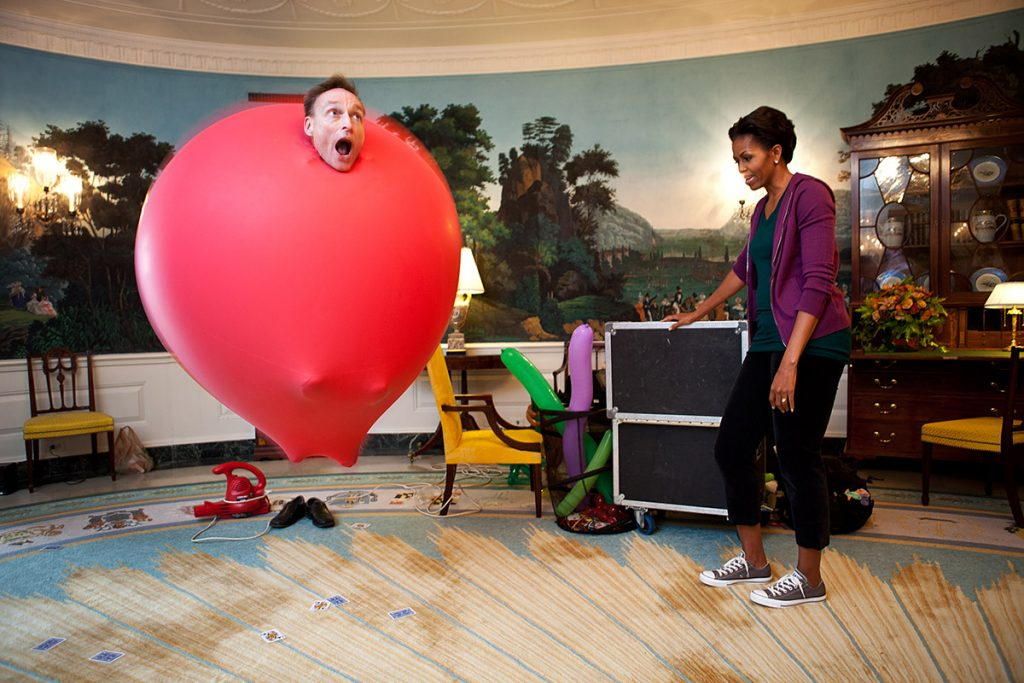 """Oct. 11, 2011""""This photograph by Chuck Kennedy has to catch your eye. It shows Guinness Book of World Records holder John Cassidy performing a balloon act for First Lady Michelle Obama in the Diplomatic Reception Room following a Let's Move event."""" (Official White House Photo by Chuck Kennedy)This official White House photograph is being made available only for publication by news organizations and/or for personal use printing by the subject(s) of the photograph. The photograph may not be manipulated in any way and may not be used in commercial or political materials, advertisements, emails, products, promotions that in any way suggests approval or endorsement of the President, the First Family, or the White House.Ę"""