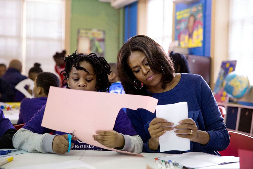 First Lady Michelle Obama assembles literacy kits during a Martin Luther King, Jr. Day of Service event at the Boys and Girls Club of Greater Washington in Washington, D.C., Jan. 19, 2015. (Official White House Photo by Pete Souza)This official White House photograph is being made available only for publication by news organizations and/or for personal use printing by the subject(s) of the photograph. The photograph may not be manipulated in any way and may not be used in commercial or political materials, advertisements, emails, products, promotions that in any way suggests approval or endorsement of the President, the First Family, or the White House.