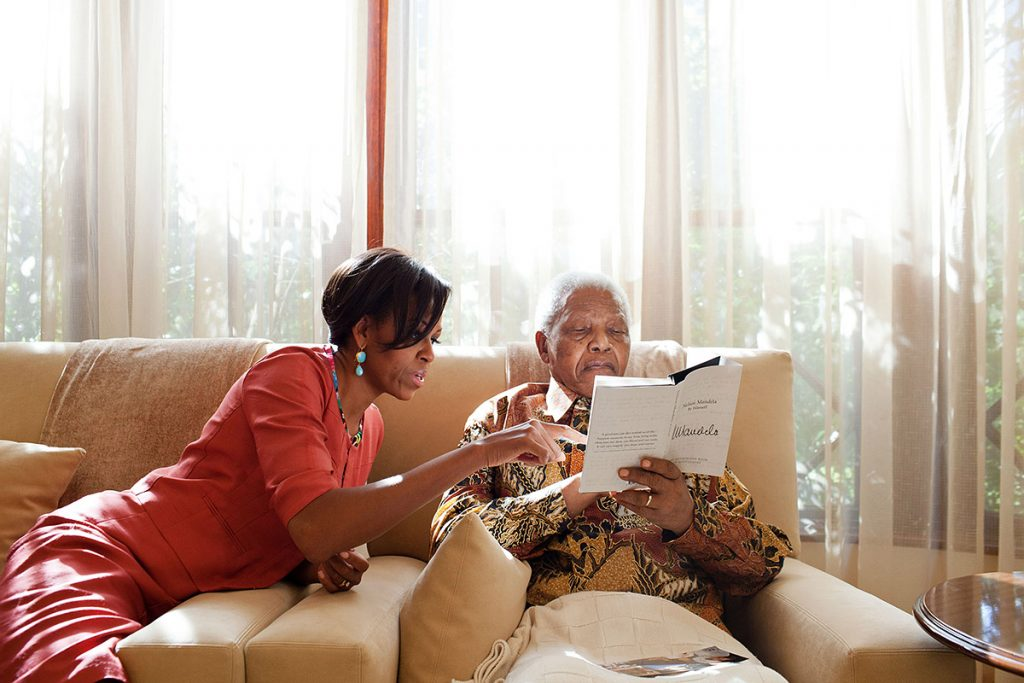 First Lady Michelle Obama meets with former President Nelson Mandela of South Africa at Mandela's home in Houghton, South Africa, June 21, 2011. (Official White House Photo by Samantha Appleton)This official White House photograph is being made available only for publication by news organizations and/or for personal use printing by the subject(s) of the photograph. The photograph may not be manipulated in any way and may not be used in commercial or political materials, advertisements, emails, products, promotions that in any way suggests approval or endorsement of the President, the First Family, or the White House.