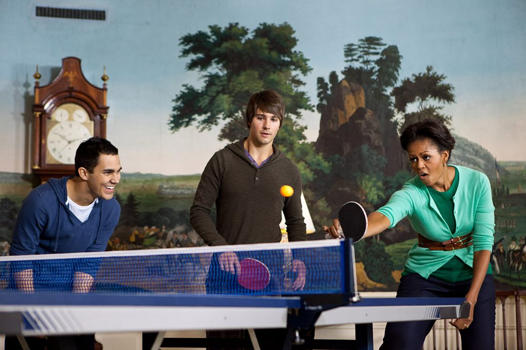 First Lady Michelle Obama plays table tennis with members of the band Big Time Rush in the Diplomatic Reception Room of the White House during a taping for NIckelodeon's Worldwide Day of Play, Saturday, Sept. 24, 2011. (Official White House Photo by Chuck Kennedy)First Lady Michelle Obama plays table tennis with members of the band Big Time Rush in the Diplomatic Reception Room of the White House while taping a message for NIckelodeon's Worldwide Day of Play, Saturday, Sept. 24, 2011. (Official White House Photo by Chuck Kennedy)