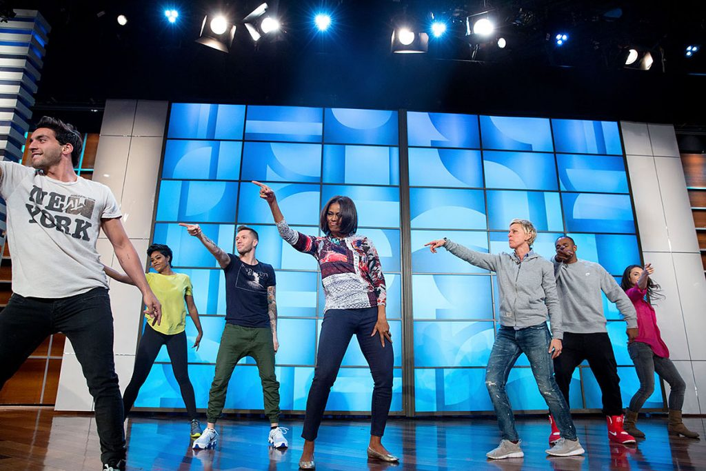 """First Lady Michelle Obama rehearses with Ellen DeGeneres and the """"So You Think You Can Dance"""" dancers for a #GimmeFive """"Let's Move!"""" dance, prior to a taping of The Ellen DeGeneres Show in Burbank, Calif., March 12, 2015. (Official White House Photo by Amanda Lucidon)This official White House photograph is being made available only for publication by news organizations and/or for personal use printing by the subject(s) of the photograph. The photograph may not be manipulated in any way and may not be used in commercial or political materials, advertisements, emails, products, promotions that in any way suggests approval or endorsement of the President, the First Family, or the White House."""