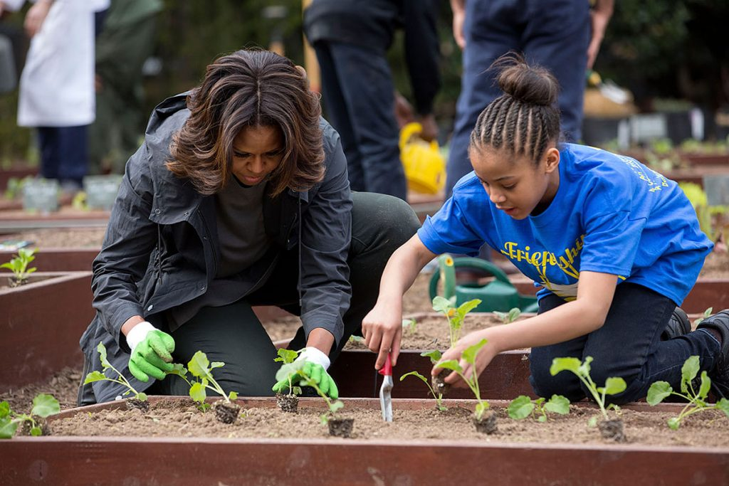First Lady Michelle Obama joins FoodCorps leaders and local students for the spring planting in the White House Kitchen Garden, April 2, 2014. (Official White House Photo by Amanda Lucidon) This official White House photograph is being made available only for publication by news organizations and/or for personal use printing by the subject(s) of the photograph. The photograph may not be manipulated in any way and may not be used in commercial or political materials, advertisements, emails, products, promotions that in any way suggests approval or endorsement of the President, the First Family, or the White House.