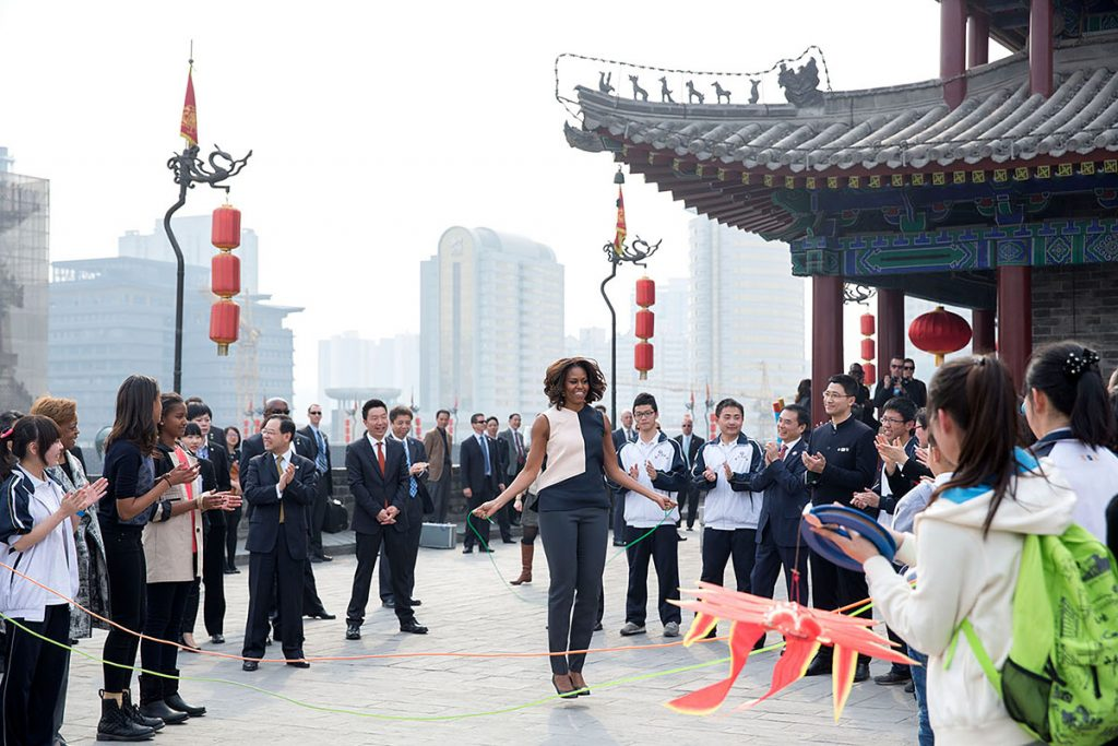 First Lady Michelle Obama, accompanied by daughters Sasha and Malia, and Marian Robinson, jumps rope as children demonstrate games during a visit to the City Wall in Xi'an, China, March 24, 2014. (Official White House Photo by Amanda Lucidon)This official White House photograph is being made available only for publication by news organizations and/or for personal use printing by the subject(s) of the photograph. The photograph may not be manipulated in any way and may not be used in commercial or political materials, advertisements, emails, products, promotions that in any way suggests approval or endorsement of the President, the First Family, or the White House.