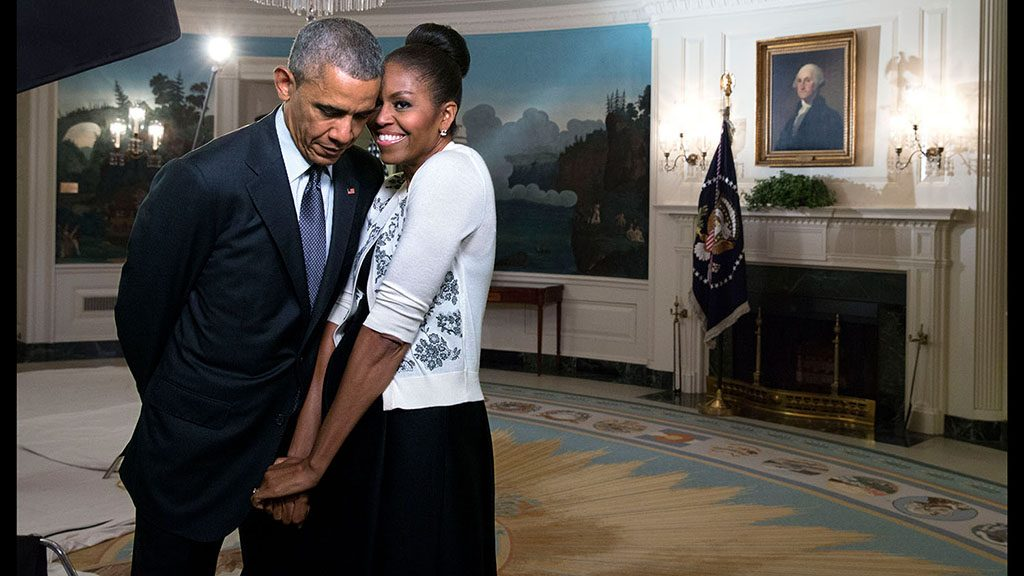 First Lady Michelle Obama snuggles against President Barack Obama before a videotaping for the 2015 World Expo, in the Diplomatic Reception Room of the White House, March 27, 2015. (Official White House Photo by Amanda Lucidon)This official White House photograph is being made available only for publication by news organizations and/or for personal use printing by the subject(s) of the photograph. The photograph may not be manipulated in any way and may not be used in commercial or political materials, advertisements, emails, products, promotions that in any way suggests approval or endorsement of the President, the First Family, or the White House.