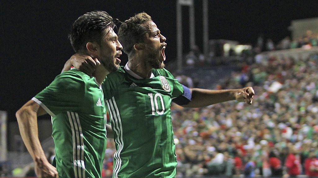 CHICAGO, UNITED STATES - OCTOBER 11:  Oribe Peralta of Mexico celebrates with Giovani dos Santos after scoring his team's first goal during the International Friendly Match between Mexico and Panama at Toyota Park on October 11, 2016 in Chicago, United States. (Photo by Omar Vega/LatinContent/Getty Images)