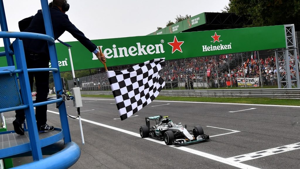 Mercedes AMG Petronas F1 Team's German driver Nico Rosberg crosses the finish line after winning the Italian Formula One Grand Prix at the Autodromo Nazionale circuit in Monza on September 4, 2016.   / AFP PHOTO / POOL / ANDREJ ISAKOVIC