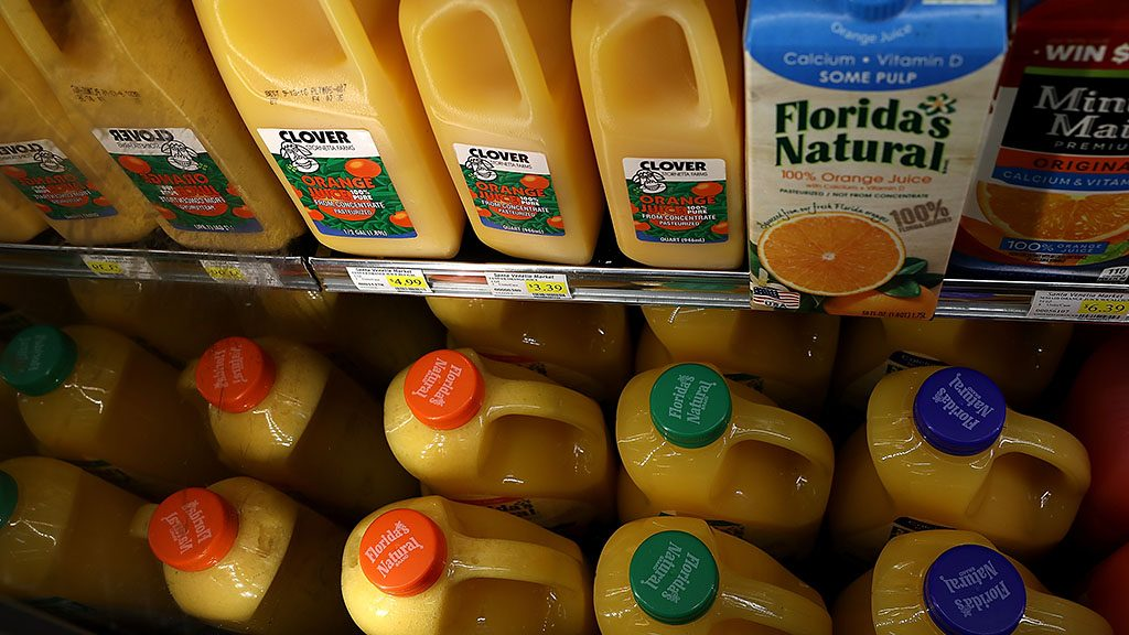 SAN RAFAEL, CA - AUGUST 30: Containers of ready to serve orange juice are displayed in a cooler at a grocery store on August 30, 2016 in San Rafael, California. Demand for ready to serve and frozen concentrated orange juice has declined to an all-time low as smoothies and energy drinks become more popular with consumers.   Justin Sullivan/Getty Images/AFP