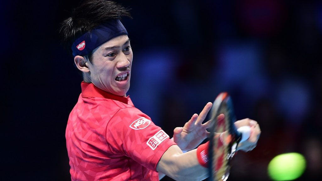 LONDON, ENGLAND - NOVEMBER 14:  Kei Nishikori of Japan plays a forehand during his Men's Singles match against Stan Wawrinka of Switzerland during day two of the Barclays ATP World Tour Finals at The O2 on November 14, 2016 in London, England.   Alex Broadway / Anadolu Agency