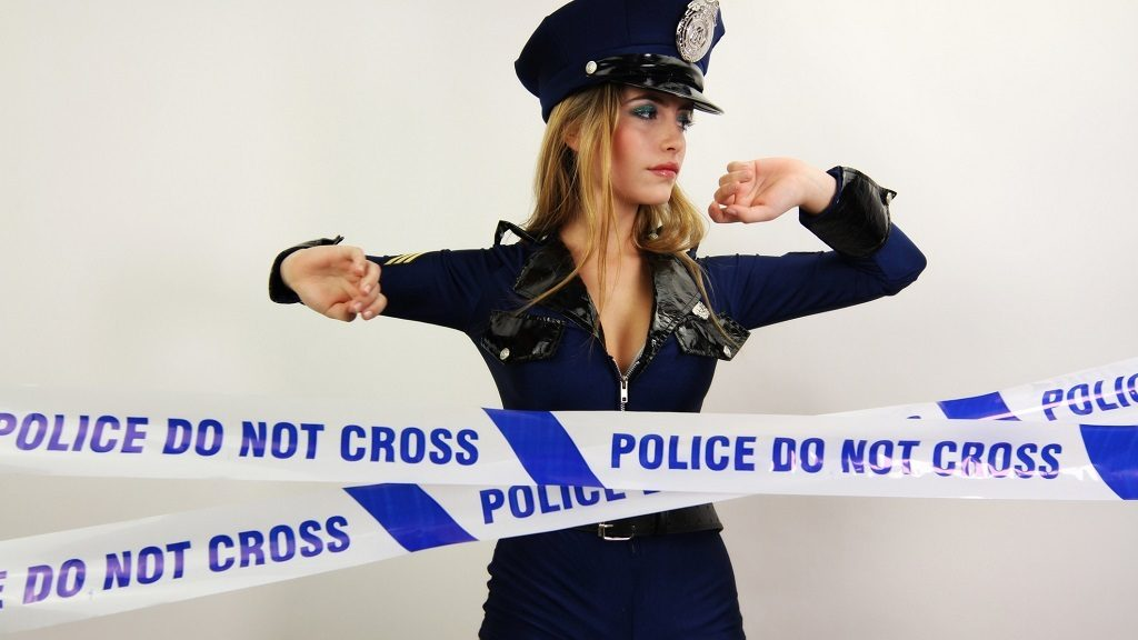 beautiful young women dancing and posing dressed as a sexy police officer. Useful for parties, clubs and events.