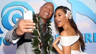 """HOLLYWOOD, CA - NOVEMBER 14: Actors Dwayne Johnson (L) and Nicole Scherzinger attend The World Premiere of Disney?s """"MOANA"""" at the El Capitan Theatre on Monday, November 14, 2016 in Hollywood, CA.   Jesse Grant/Getty Images for Disney/AFP"""