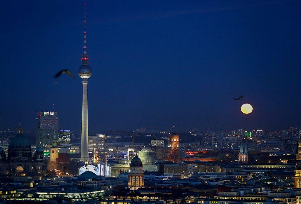 The colourful moon rising above Berlin, Germany, 14 November 2016. PHOTO: KAY NIETFELD/dpa