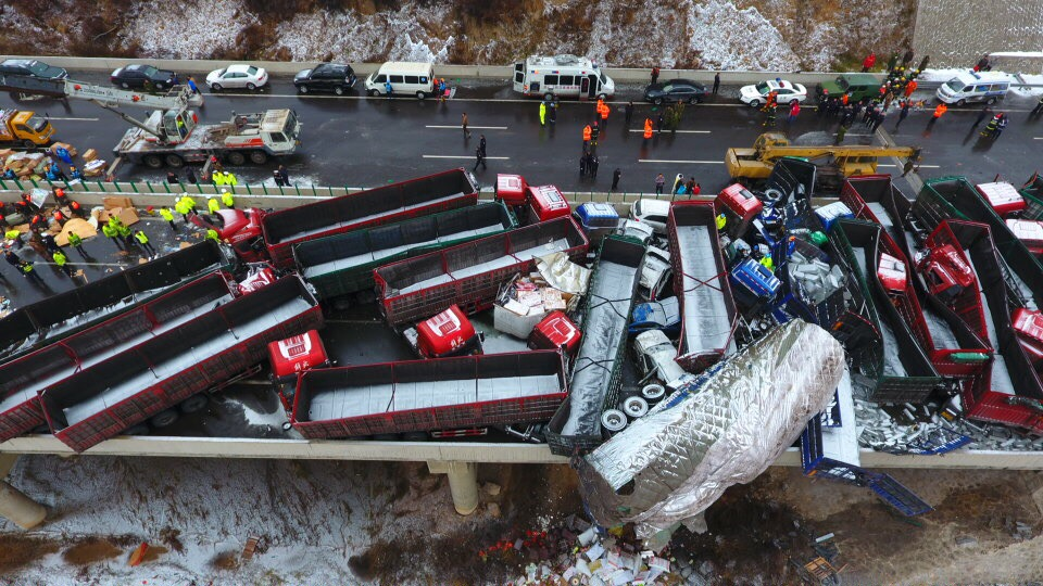 Aerial view of damaged vehicles after the pile-up on the Beijing–Kunming Expressway in Pingyang, north China's Shanxi province, 21 November 2016.  Four people were killed and another 40 injured in an accident when a pile-up on an expressway in north China's Shanxi province, Monday (21 November 2016) morning. The pile-up took place around 9:00 am and 37 vehicles were involved in the accident on the highway linking Beijing and Kunming. Slippery road as a result of heavy fog was thought to be the cause of the pile-up.