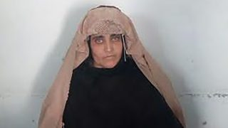 """In this handout photograph released by Pakistan's Federal Investigation Agency (FIA) on October 26, 2016, Afghan Sharbat Gula,  the 'Afghan Girl' who appeared on the cover of a 1985 edition of National Geographic magazine, waits ahead of a court hearing in  Peshawar. ---RESTRICTED TO EDITORIAL USE - MANDATORY CREDIT """"AFP PHOTO / FIA """" - NO MARKETING NO ADVERTISING CAMPAIGNS - DISTRIBUTED AS A SERVICE TO CLIENTS --- / XGTY An Afghan woman immortalised on a celebrated National Geographic magazine cover as a green-eyed 12-year-old girl was arrested October 26 for living in Pakistan on fraudulent identity papers. The haunting image of Sharbat Gula, taken in a Pakistan refugee camp by photographer Steve McCurry, became the most famous cover image in the magazine's history.  / AFP PHOTO / FIA / HO / RESTRICTED TO EDITORIAL USE - MANDATORY CREDIT """"AFP PHOTO / FIA"""" - NO MARKETING NO ADVERTISING CAMPAIGNS - DISTRIBUTED AS A SERVICE TO CLIENTS - NO ARCHIVE"""