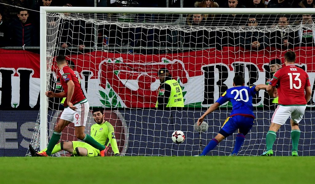 Hungary's Adam Szalai (L) scores a goal against Andora's goalkeeper Josep Gomes (2ndL) and Max Llovera (R) during the World Cup 2018 qualification football match between Hungary and Andora in Budapest on November 13, 2016.  / AFP PHOTO / ATTILA KISBENEDEK