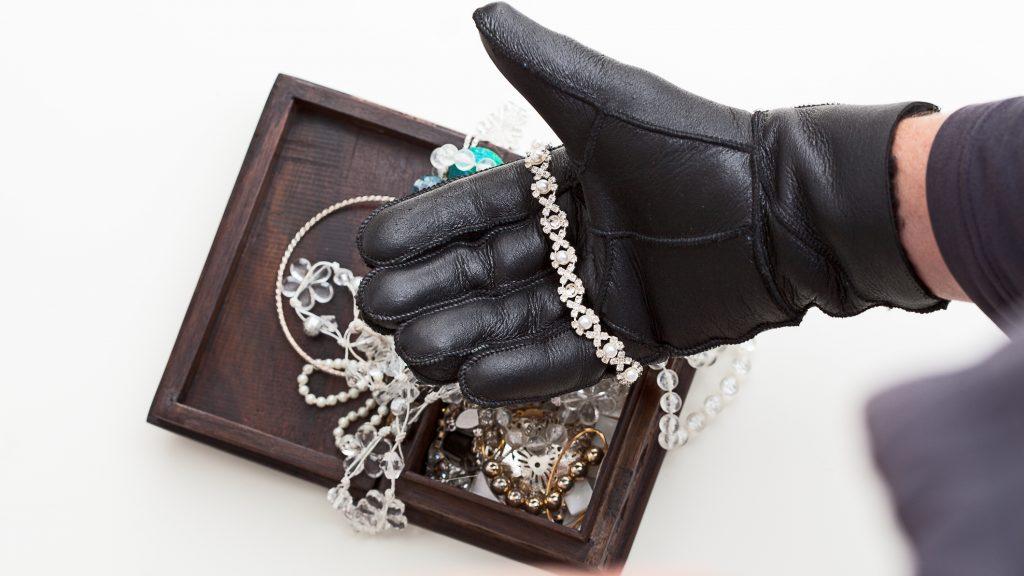 Burglar is stealing expensive jewelry
