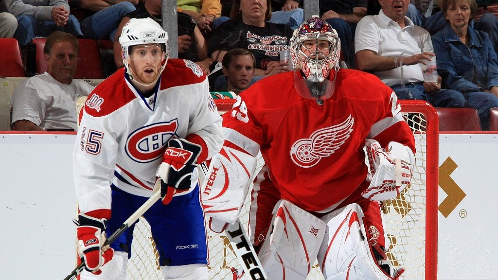 DETROIT - SEPTEMBER 24: Thomas Beauregard #45 of the Montreal Canadiens sets up next to Ty Conklin #29 of the Detroit Red Wings during the pre-season opener on September 24, 2008 at Joe Louis Arena in Detroit, Michigan. Montreal won in a overtime shootout 3-2  (Photo by Dave Reginek/NHLI via Getty Images)