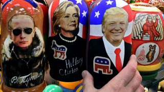 Traditional Russian wooden nesting dolls, Matryoshka dolls, depicting Russia's President Vladimir Putin, US Democratic presidential nominee Hillary Clinton and US Republican presidential nominee Donald Trump are seen on sale at a gift shop in central Moscow on November 8, 2016.A nervous world turned its gaze to America's 200 million-strong electorate November 8, 2016 as it chooses whether to send the first female president or a populist property tycoon to the White House. / AFP PHOTO / Kirill KUDRYAVTSEV
