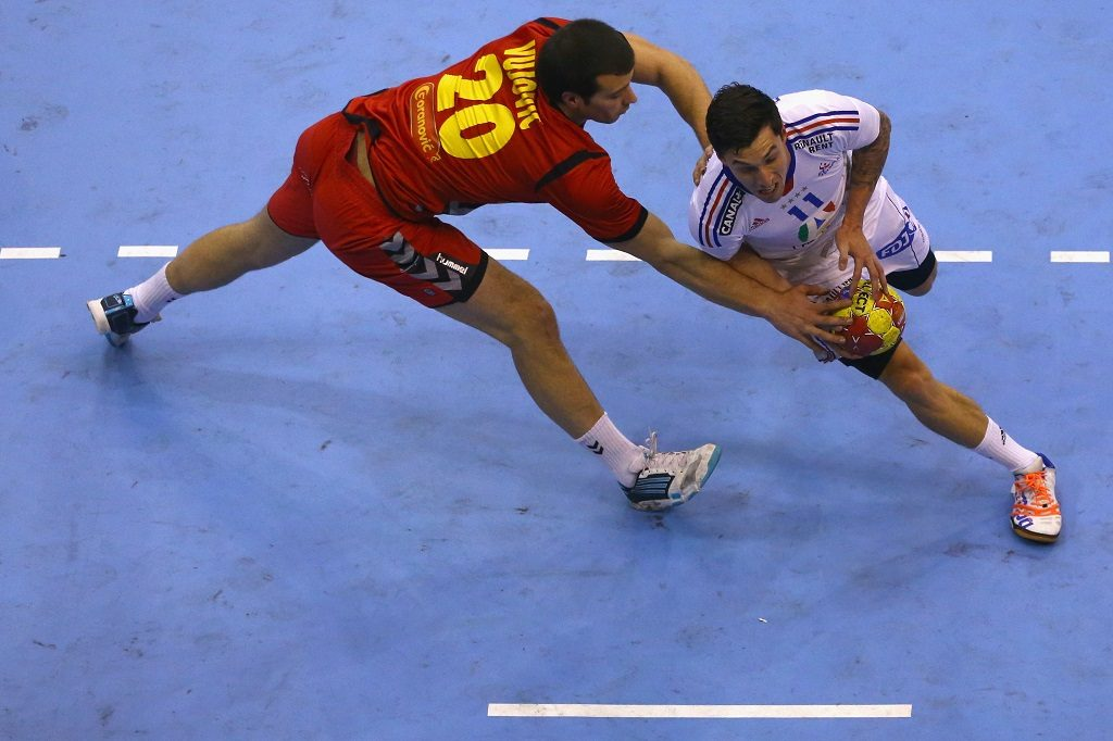 GRANOLLERS, SPAIN - JANUARY 13: (L-R) Stevan Vujovic of Montenegro defends against Samuel Honrubia of France during the premilary group A match between Montenegro and France at Palacio de Deportes de Granollers on January 13, 2013 in Granollers, Spain. (Photo by Christof Koepsel/Getty Images)