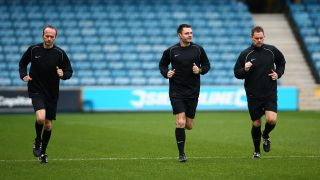 LONDON, ENGLAND - JANUARY 18:  Referee Eddie Ilderton (C) warms up with assistant referees Ian Cooper (left) and Robert Whitton ahead of the Sky Bet Championship match between Millwall and Ipswich Town at The Den on January 18, 2014 in London, England, (Photo by Jordan Mansfield/Getty Images)