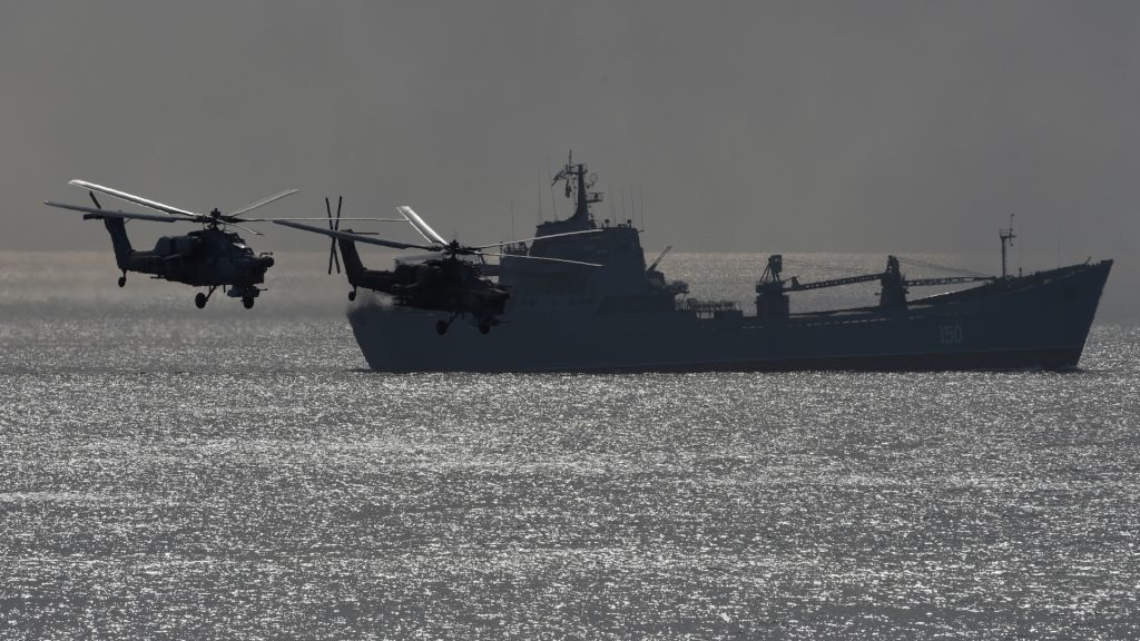 Russia's navy ships and helicopters take part in a military exercise called Kavkaz (the Caucasus) 2016 at the coast of the Black Sea in Crimea on September 9, 2016. / AFP PHOTO / VASILY MAXIMOV
