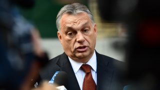 Hungarian Prime Minister Viktor Orban answers to the journalists in front of a polling station at a school in Budapest, on October 2, 2016.  Hungarians vote in a referendum on taking migrants as part of an EU-wide mandatory quota scheme, a plan rejected by right-wing Prime Minister Viktor Orban. / AFP PHOTO / ATTILA KISBENEDEK