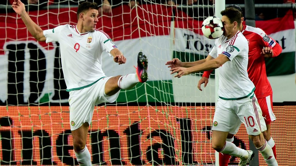 Hungary's Zoltan Gera (R) and Adam Szalai react during the World Cup 2018 football qualification match between Hungary and Switzerland at the Groupama Arena in Budapest on October 7, 2016.  / AFP PHOTO / ATTILA KISBENEDEK