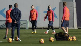 Barcelona's midfielder Andres Iniesta (L) and Barcelona's Argentinian forward Lionel Messi take part in a training session at the Sports Center FC Barcelona Joan Gamper in Sant Joan Despi, near Barcelona on December 2, 2016 on the eve their Spanish League Clasico football match FC Barcelona vs Real Madrid.  / AFP PHOTO / JOSEP LAGO