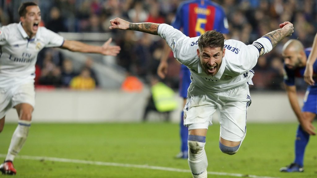 Real Madrid's defender Sergio Ramos celebrates after scoring a goal  during the Spanish league football match FC Barcelona vs Real Madrid CF at the Camp Nou stadium in Barcelona on December 3, 2016. / AFP PHOTO / PAU BARRENA