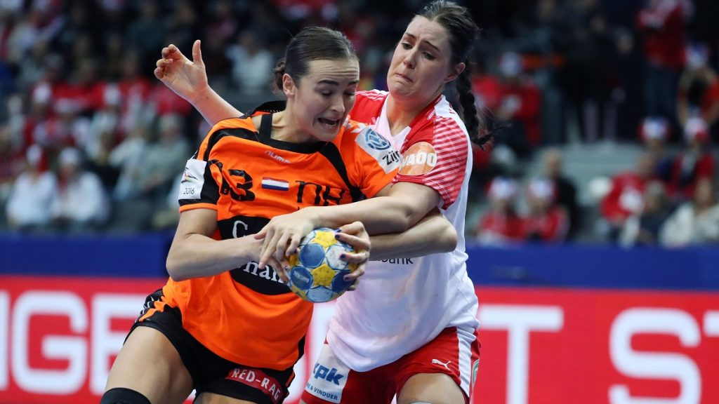 Netherlands' Yvette Broch is stoped by Denmark's Stine Bodholt Nielsen during woman's European Championship handball semi-final between Netherlands and Denmark in Gothenburg, Sweden on December 16, 2016.   / AFP PHOTO / TT NEWS AGENCY AND TT News Agency / Bjorn LARSSON ROSVALL / Sweden OUT
