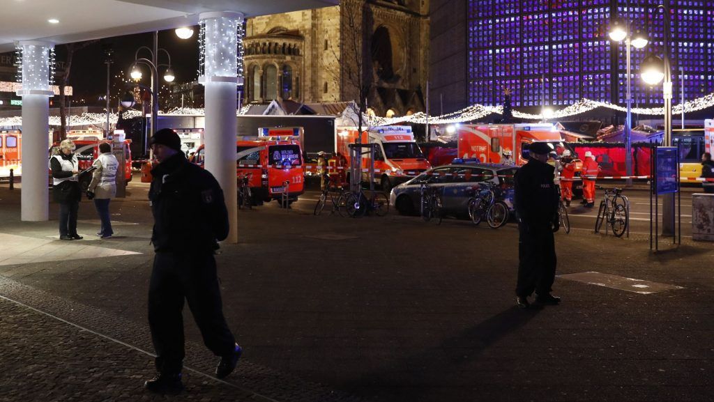A policeman stands near the site where a truck speeded into a christmas market in Berlin, on December 19, 2016 killing nine persons and injuring at least 50 people. Ambulances and police rushed to the scene after the driver drove up the pavement of the market in a central square popular with tourists less than a week before Christmas, in a scene reminiscent of the deadly truck attack in Nice. / AFP PHOTO / Odd ANDERSEN