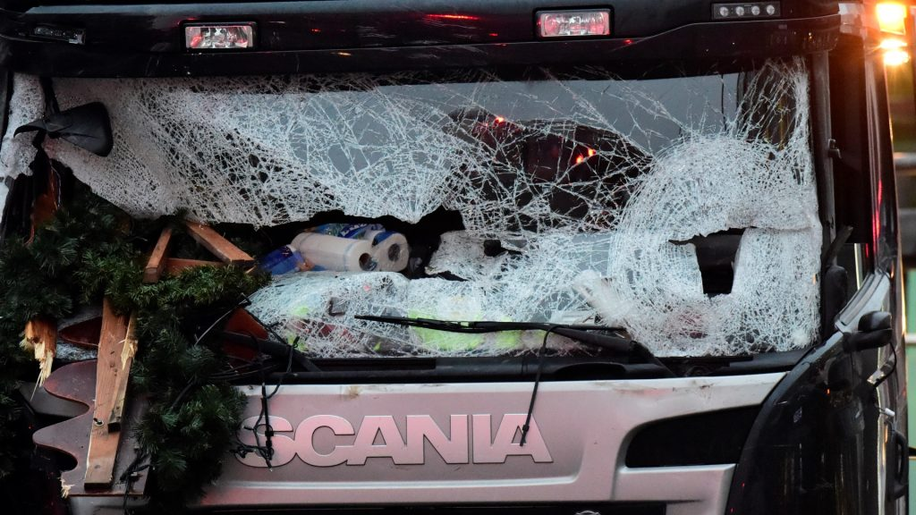 """The broken wind shield of a truck that crashed into a Christmas market near the Kaiser-Wilhelm-Gedaechtniskirche (Kaiser Wilhelm Memorial Church) in Berlin is pictured on December 20, 2016. German police said they were treating as """"a probable terrorist attack"""" the killing of 12 people when the speeding lorry cut a bloody swath through the packed Berlin Christmas market. / AFP PHOTO / Tobias SCHWARZ"""