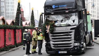 """View of the truck that crashed the evening before into a christmas market at Gedächtniskirche church on early December 20, 2016 in Berlin. German police said December 20, 2016 they were treating as """"a probable terrorist attack"""" the killing of 12 people when a lorry ploughed through a packed Berlin Christmas market. / AFP PHOTO / Tobias SCHWARZ"""