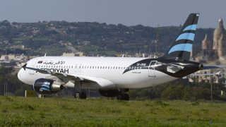 A picture taken on December 23, 2016 shows a hijacked Airbus A320 operated by Afriqiyah Airways after it landed at Luqa Airport, in Malta.A hijacked plane from Libya landed on the Mediterranean island of Malta on December 23 with 118 people including seven crew members on board, Malta's prime minister and government sources said. The Airbus A320 had been on a domestic Libyan route operated by Afriqiyah Airways from Sabha in the south to the capital Tripoli but was re-routed. / AFP PHOTO / Matthew Mirabelli / Malta OUT