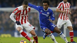 Stoke City's Dutch midfielder Ibrahim Afellay (L) vies with Chelsea's Brazilian midfielder Willian during the English Premier League football match between Chelsea and Stoke City at Stamford Bridge in London on December 31, 2016. / AFP PHOTO / Ian KINGTON / RESTRICTED TO EDITORIAL USE. No use with unauthorized audio, video, data, fixture lists, club/league logos or 'live' services. Online in-match use limited to 75 images, no video emulation. No use in betting, games or single club/league/player publications.  /