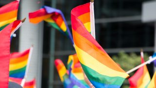 CANADA, Montreal: Rainbow flags are waved during Montreal's Pride Parade on August 14, 2016. The parade took place on Rene-Levesque st. A minute of silence was observed in memory of Orlando's shooting victims. - Josie Desmarais