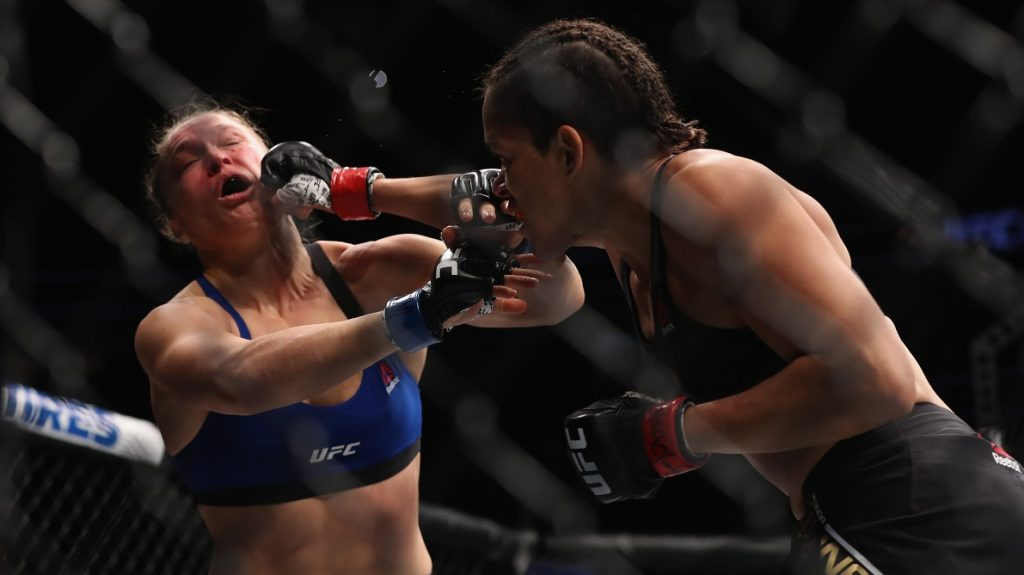 LAS VEGAS, NV - DECEMBER 30: (R-L) Amanda Nunes of Brazil punches Ronda Rousey in their UFC women's bantamweight championship bout during the UFC 207 event on December 30, 2016 in Las Vegas, Nevada.   Christian Petersen/Getty Images/AFP