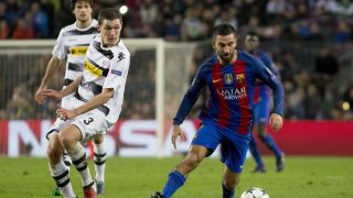 BARCELONA, SPAIN - DECEMBER 6: Barcelona's Arda Turan (R) in action during the UEFA Champions League match between the FC Barcelona and Borussia Mönchengladbach at Camp Nou stadium in Barcelona, Spain on December 6, 2016. Albert Llop / Anadolu Agency