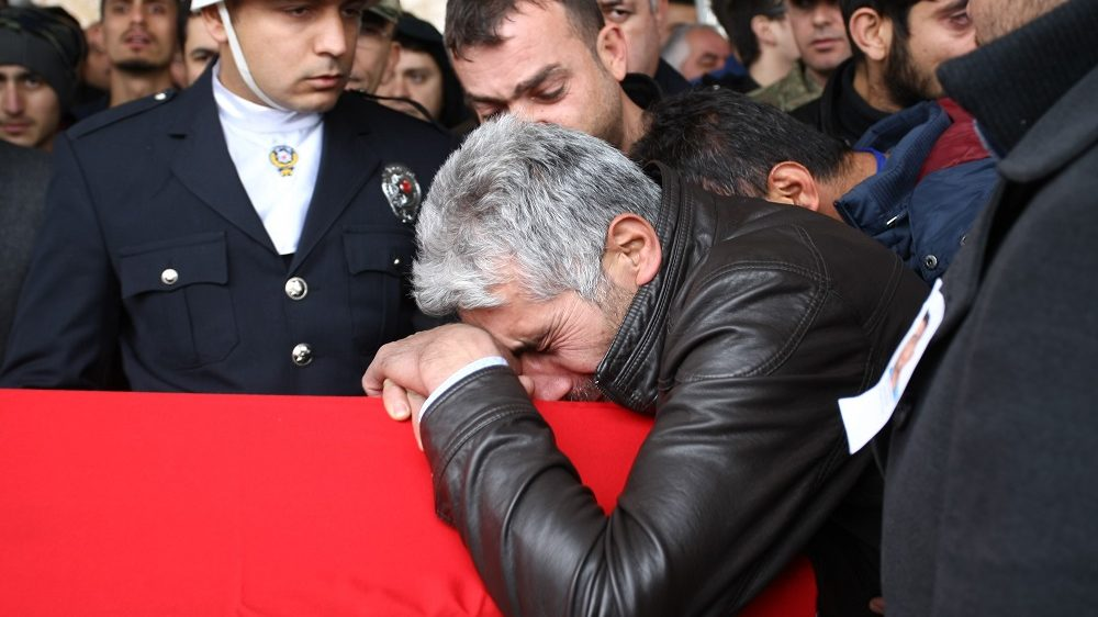 MALATYA, TURKEY - DECEMBER 12 : Relatives of martyred policemen Hamdi Dikmen and Okan Dogan, mourn during a funeral ceremony in Malatya, Turkey on December 12, 2016. At least 38 people, including 7 civilians, were killed and 155 people were injured in two separate bomb attacks in the Besiktas district of Istanbul on December 10, 2016. Emrah Gokmen / Anadolu Agency