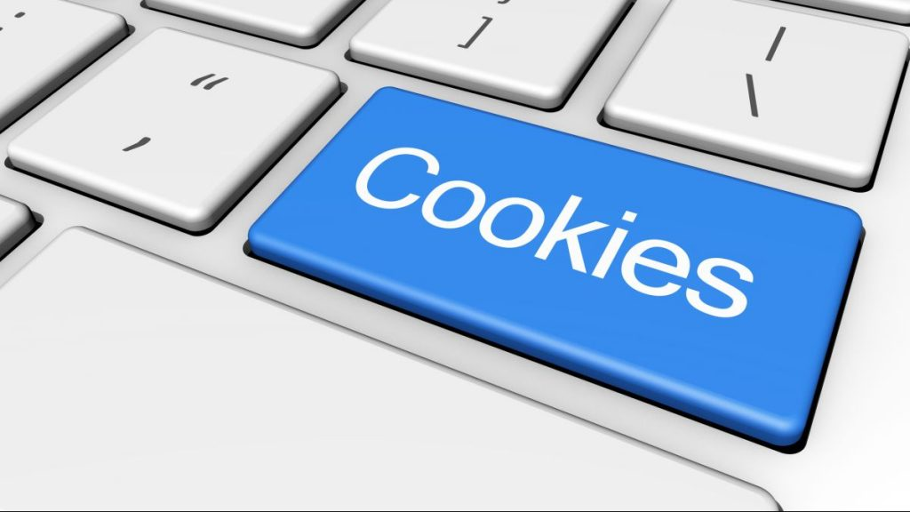 Internet browser and web concept with cookies sign and word on a blue computer key.