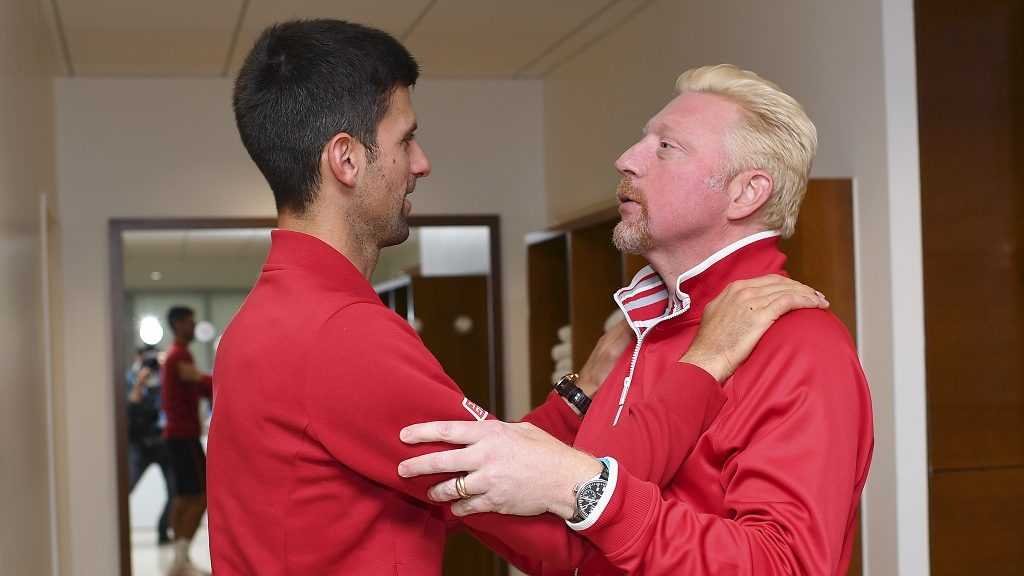 """A handout photo released by the Federation Francaise de Tennis (FFT) shows Serbia's Novak Djokovic (L) speaking to his coach former German tennis player Boris Becker in the locker room after winning the men's final match against Britain's Andy Murray at the Roland Garros 2016 French Tennis Open in Paris on June 5, 2016. / AFP PHOTO / FEDERATION FRANCAISE DE TENNIS / NICOLAS GOUHIER / RESTRICTED TO EDITORIAL USE - MANDATORY CREDIT """"AFP PHOTO / FEDERATION FRANCAISE DE TENNIS / NICOLAS GOUHIER """" - NO MARKETING - NO ADVERTISING CAMPAIGNS - DISTRIBUTED AS A SERVICE TO CLIENTS"""