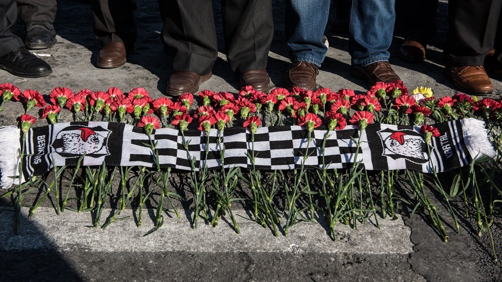 ISTANBUL, TURKEY - DECEMBER 11: People leave red carnations as they visit the scene of Saturday's blasts in Istanbul, December 11, 2016 Turkey. According to Interior Minister Suleyman Soylu, at least 38 people were killed and 166 other wounded in twin explosions outside Besiktas FC's Vodafone Arena Stadium and in nearby Macka Park a few hours after the night's soccer match on 10 December. The bombs apparently targeted police officers who were securing the match. (Photo by Burak Kara/Getty Images)