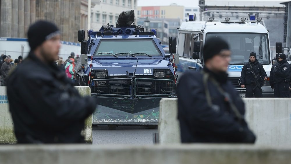 BERLIN, GERMANY - DECEMBER 23:  Heavily-armed police stand behind concrete security barriers and a police armoured vehicle near the Brandenburg Gate prior to a concert there on December 23, 2016 in Berlin, Germany. German authorities remain on high alert following the shooting of terror suspect Anis Amri by Italian police in Milan. Amri, who is thought to be the driver who drove a truck into a Berlin Christmas market on December 19, killing 12 people and injuring dozens, possibly had accomplices in the Berlin Islamist scene.   (Photo by Sean Gallup/Getty Images)