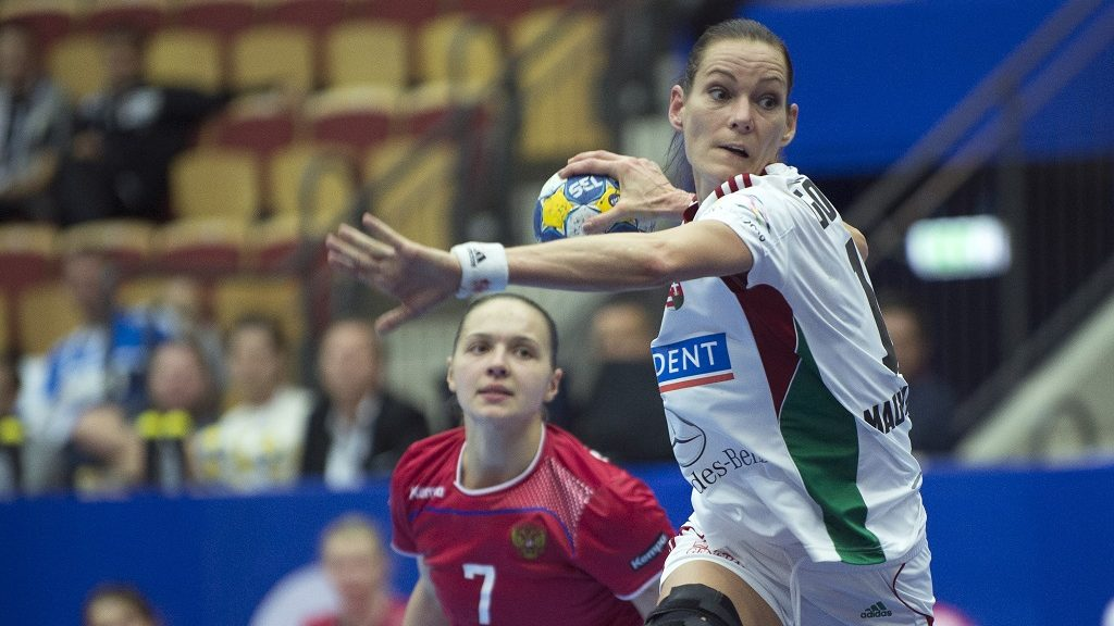 Hungary's Anita Gorbicz (R) prepares to shoot as Russia's Daria Dmitrieva looks on during the Women's European Handball Championship group 2 main round match between Hungary and Russia in Helsingborg, Sweden, on December 14, 2016.  / AFP PHOTO / TT News Agency / Bjorn Lindgren / Sweden OUT