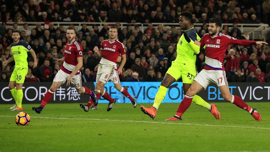 Liverpool's Belgian striker Divock Origi (2R) scores his team's second goal past Middlesbrough's Spanish defender Antonio Barragan during the English Premier League football match between Middlesbrough and Liverpool at Riverside Stadium in Middlesbrough, northeast England on December 14, 2016. / AFP PHOTO / Lindsey PARNABY / RESTRICTED TO EDITORIAL USE. No use with unauthorized audio, video, data, fixture lists, club/league logos or 'live' services. Online in-match use limited to 75 images, no video emulation. No use in betting, games or single club/league/player publications.  /
