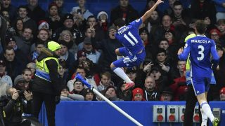 Chelsea's Spanish midfielder Pedro (C) celebrates scoring the opening goal during the English Premier League football match between Chelsea and Bournemouth at Stamford Bridge in London on December 26, 2016. / AFP PHOTO / Ben STANSALL / RESTRICTED TO EDITORIAL USE. No use with unauthorized audio, video, data, fixture lists, club/league logos or 'live' services. Online in-match use limited to 75 images, no video emulation. No use in betting, games or single club/league/player publications.  /