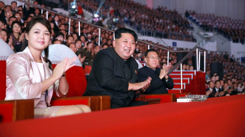 """This undated picture released from North Korea's official Korean Central News Agency (KCNA) on October 19, 2015 shows North Korean leader Kim Jong-Un (C), accompanied by his wife Ri Sol-Ju (L), enjoying a joint performance by the state merited chorus and the Moranbong band for celebrating the 70th founding anniversary of the Workers' Party of Korea (WPK) at the Ryugyong Chung Ju-yung gymnasium in Pyongyang. AFP PHOTO / KCNA via KNS    REPUBLIC OF KOREA OUT THIS PICTURE WAS MADE AVAILABLE BY A THIRD PARTY. AFP CAN NOT INDEPENDENTLY VERIFY THE AUTHENTICITY, LOCATION, DATE AND CONTENT OF THIS IMAGE. THIS PHOTO IS DISTRIBUTED EXACTLY AS RECEIVED BY AFP. ---EDITORS NOTE--- RESTRICTED TO EDITORIAL USE - MANDATORY CREDIT """"AFP PHOTO / KCNA VIA KNS"""" - NO MARKETING NO ADVERTISING CAMPAIGNS - DISTRIBUTED AS A SERVICE TO CLIENTS / AFP PHOTO / KCNA / KNS"""