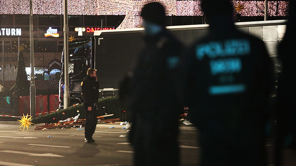 Security stand and guard the area after a lorry truck ploughed through a Christmas market on December 19, 2016 in Berlin, Germany. Several people have died while dozens have been injured as police investigate the attack at a market outside the Kaiser Wilhelm Memorial Church on the Kurfuerstendamm and whether it is linked to a terrorist plot. (Photo by Omer Messinger/NurPhoto via Getty Images)